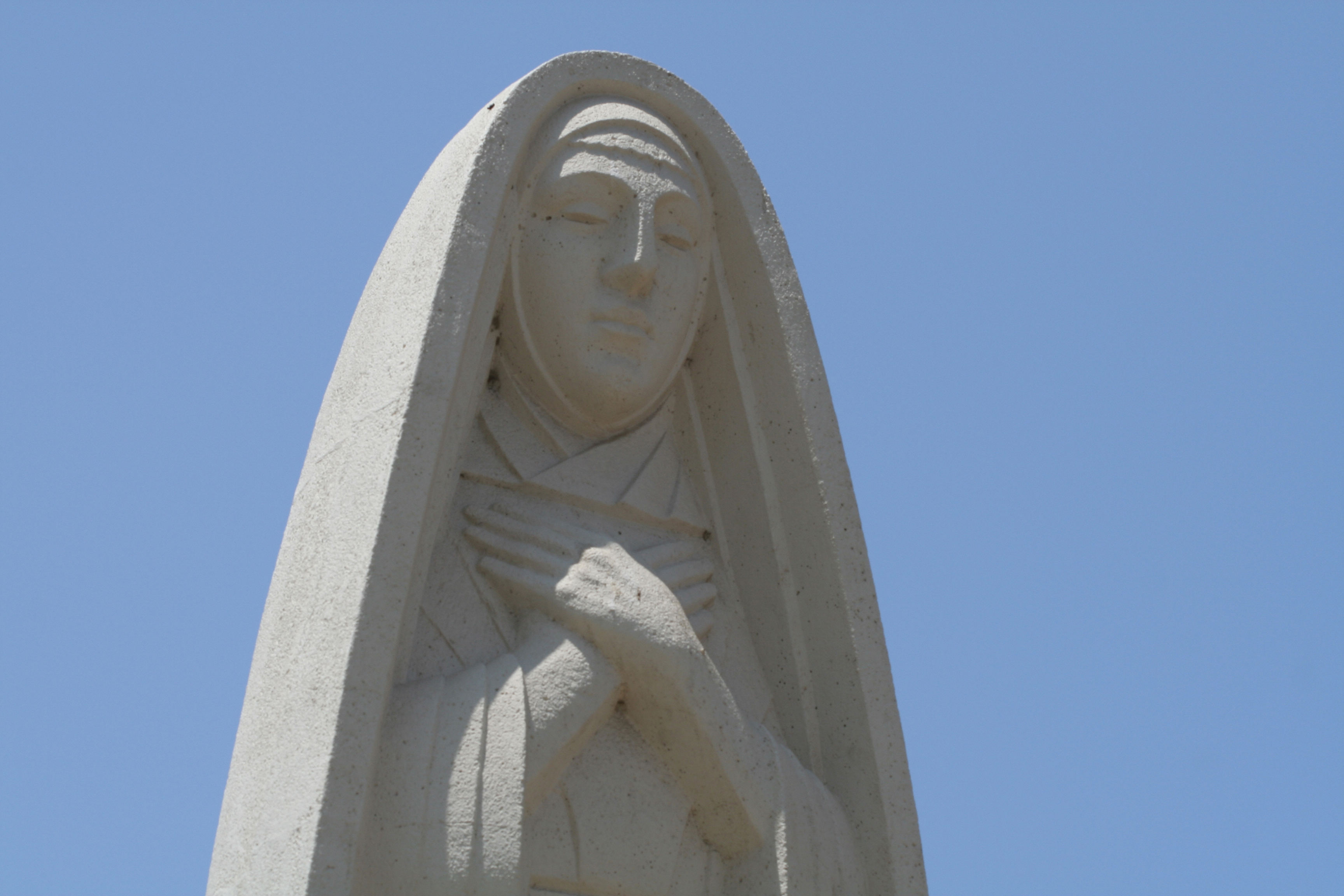 The art deco statue of Saint Monica  still stands in the city's public park